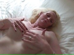 Ample breasted mature pulls on her puffies