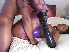 Blue latex above a jet-black girl doing hot arse lady-love